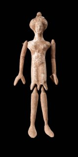 Jointed doll. Wreath, and high pointed hair. Circular disc in left hand. Traces of white. Legs and arms jointed. 92.2616